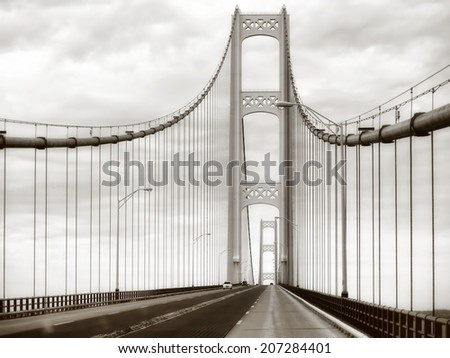Retro Mackinac Bridge steel, metal suspension bridge in Michigan USA in sepia - stock photo