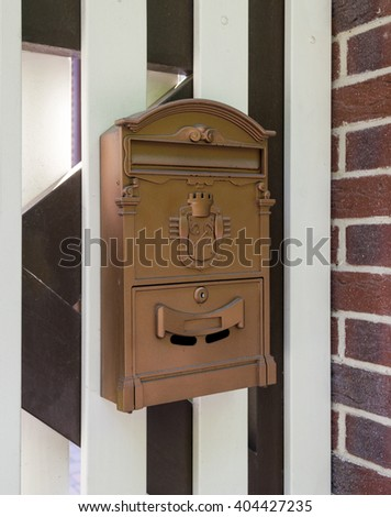 Retro mailbox on the fence - stock photo