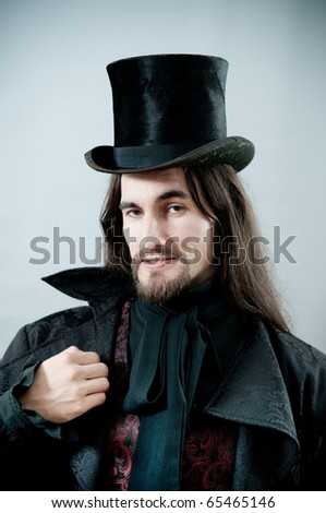 Retro man with black cylinder - stock photo