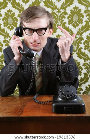 Retro manager angry on the phone - stock photo