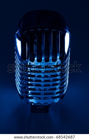 Retro Mic close up on silver background - stock photo