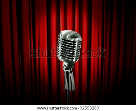 retro microphone and red curtain - stock photo