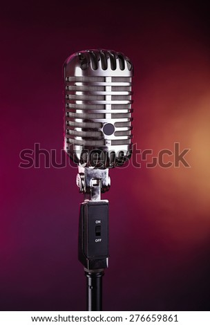 Retro microphone on colorful blurred background - stock photo