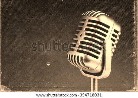 Retro microphone.  Vintage style or worn paper photo image - stock photo