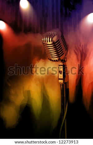 Retro microphone with concert crowd in background - stock photo