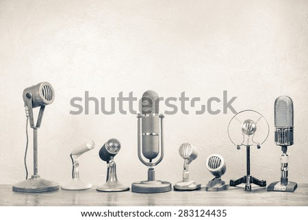 Retro microphones for press conference or interview. Vintage old style sepia photo - stock photo
