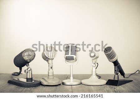 Retro microphones for press conference or interview. Vintage old style sepia photography - stock photo