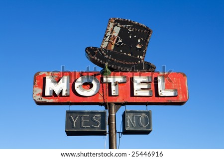 retro motel sign from an abandoned motel deep in rural US against clear blue sky - stock photo