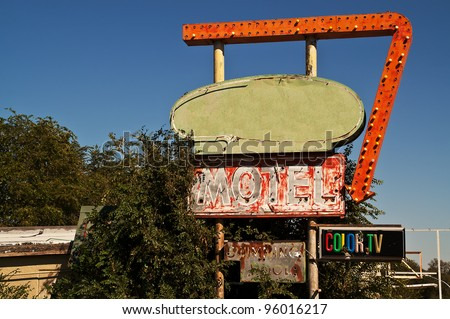 Retro motel sign on Route 66 with signs for a swimming pool and color TV - stock photo