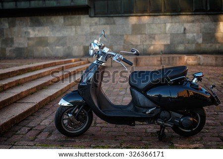 Retro moto scooter on the street. - stock photo