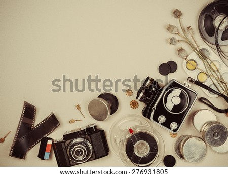 Retro movie camera  and photo camera with accessories - stock photo