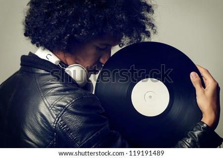 retro music dj portrait with old vinyl record - stock photo