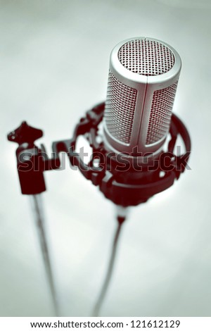 Retro music microphone in vintage style - stock photo