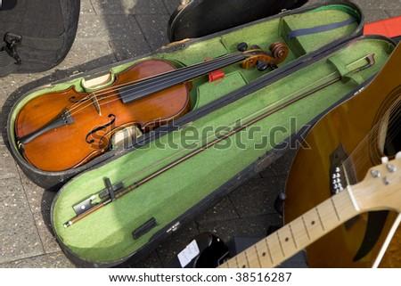 Retro musical grunge violin background  on market in UK - stock photo