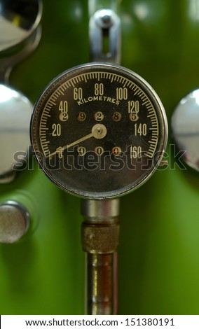 Retro Odometer On A Vintage Green Motorcycle - stock photo