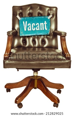 Retro office chair with vacant job sign isolated on a white background - stock photo