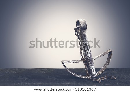 Retro Old anchor on pastel background - stock photo