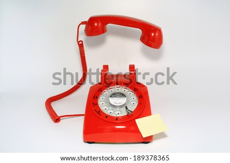 retro old fashion rotary dial phone pick up by hollow man and ready with blank memo