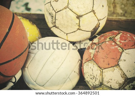 Retro old film stylized used balls in a basket, shallow depth of field. - stock photo