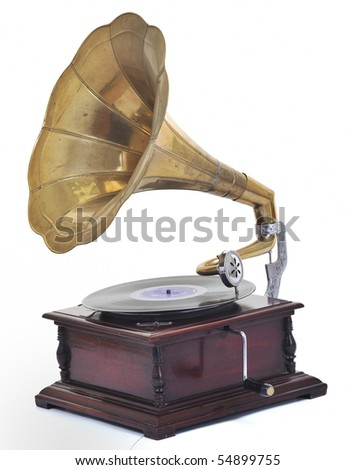 retro old gramophone for playing music over plates  isolated on white in studio - stock photo
