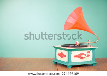 Retro old gramophone front mint green background - stock photo