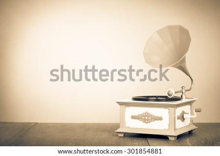 Retro old gramophone radio. Vintage style sepia photo - stock photo