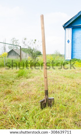 Retro old metal shovel on the ground in the garden - stock photo