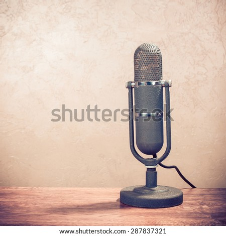 Retro old microphone from 50s on table. Vintage instagram style filtered photo - stock photo