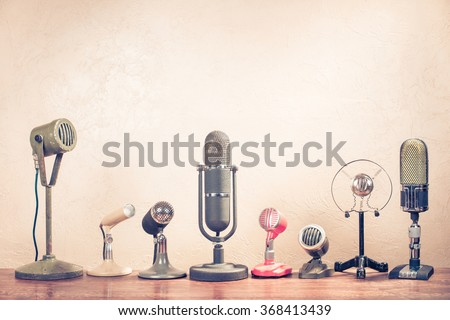 Retro old microphones on table. Vintage style filtered photo