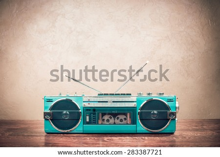 Retro old mint green radio recorder from 80s front grunge wall background. Vintage instagram style filtered photo - stock photo