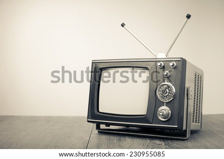 Retro old portable television. Vintage style sepia photo - stock photo