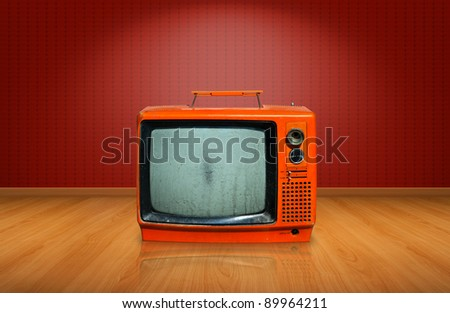 Retro, old television on wooden floor - stock photo