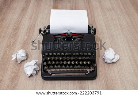 Retro old typewriter with crumpled paper.  - stock photo