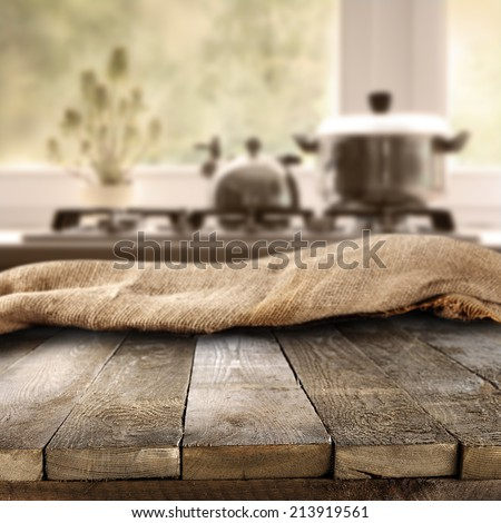 retro old worn used table and kitchen space  - stock photo