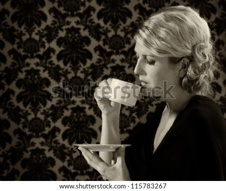 Retro or vintage looking woman drinking tea or coffee