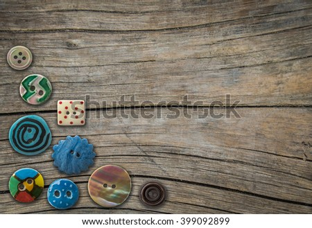 Retro Ornamental Vintage Buttons On A Rustic Wooden Table With Copy Space - stock photo