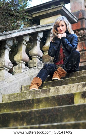 Retro Outdoor Portrait Of Young Woman On Steps - stock photo