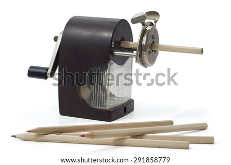 Retro pencil sharpener and colored pencils - stock photo
