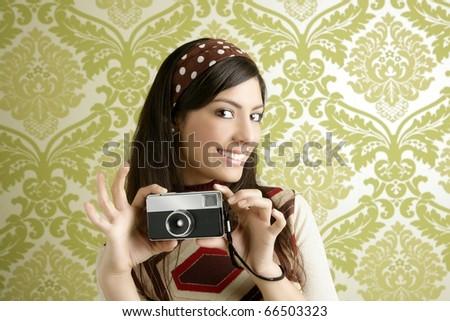 Retro photo camera shooting woman green sixties wallpaper vintage - stock photo