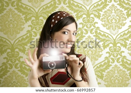 Retro photo camera shooting woman green sixties wallpaper vintage [Photo Illustration]