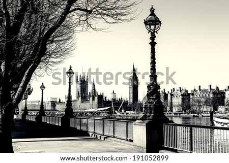 Retro Photo Effect - Lamp on South Bank of River Thames with Big Ben and Palace of Westminster in Background, London, England, UK - stock photo