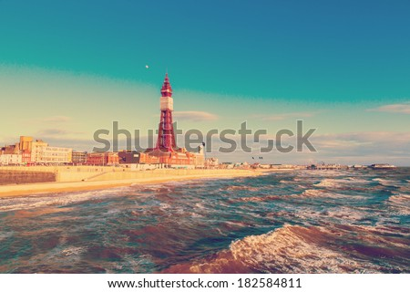 Retro Photo Filter Effect Blackpool Tower, from the North Pier, Lancashire, England, UK - stock photo
