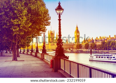 Retro Photo  Filter Effect - Street Lamp on South Bank of River Thames with Big Ben and Palace of Westminster in Background, London, England, UK - stock photo