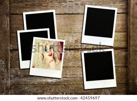 Retro photo frames on wood - stock photo