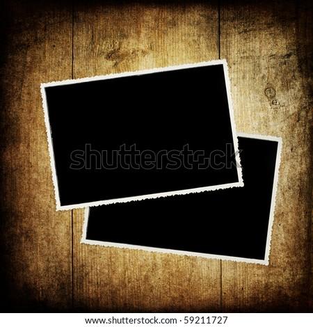 Retro photo frames on wood texture. - stock photo