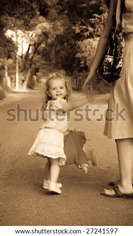 Retro photo little girl with mather - stock photo