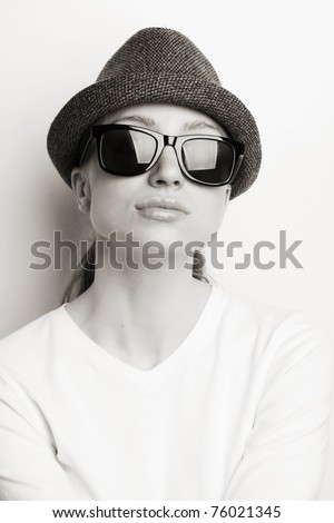 Retro photo of a girl in sunglasses and an old hat ( black and white shoot)