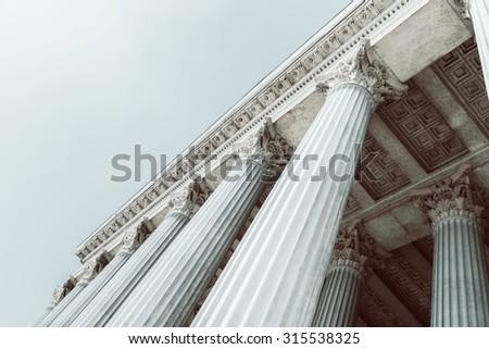Retro Photo Of Composite Greek Style Columns - stock photo