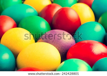 Retro Photo Of Easter Eggs Pile In Basket - stock photo