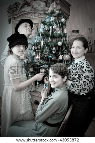Retro photo of Family near Christmas tree at home - stock photo